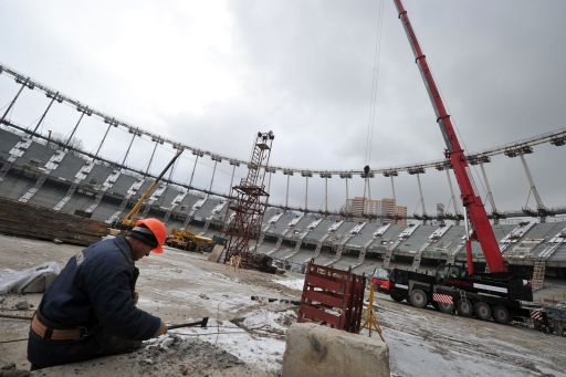 Workers work on the construction site of Olympiyski stadium in Kiev on January 24, 2011.Poland and Ukraine will co-host the 2012 European Soccer Championship. AFP PHOTO/ SERGEI SUPINSKY
