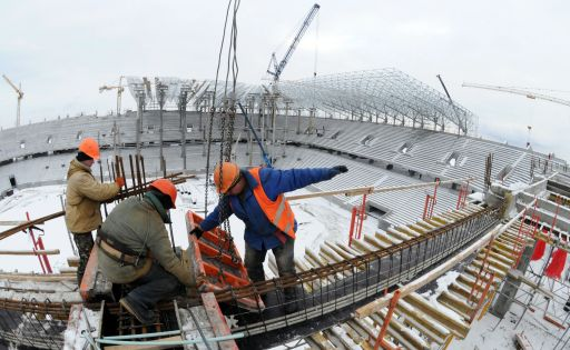 Workers are seen in the stadium under construction, in the western Ukrainian city of Lviv, on January 24, 2011. Poland and Ukraine will co-host the 2012 European Football Championship. AFP PHOTO/ YURIY DYACHYSHYN