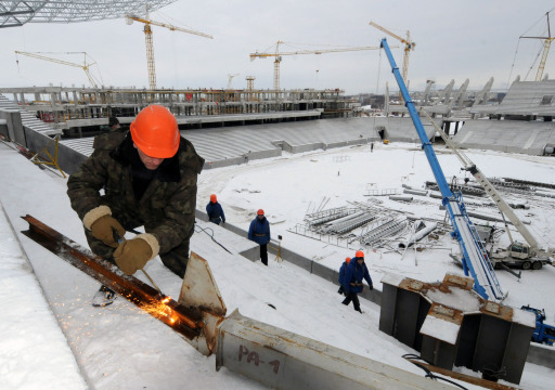 A worker welds a piece of steel  in the stadium under construction, in the western Ukrainian city of Lviv, on January 24, 2011. Poland and Ukraine will co-host the 2012 European Football Championship. AFP PHOTO/ YURIY DYACHYSHYN