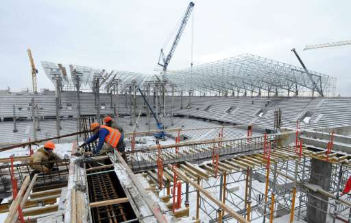 Workers work Workers are seen in the stadium under construction, in the western Ukrainian city of Lviv, on January 24, 2011. Poland and Ukraine will co-host the 2012 European Football Championship. AFP PHOTO/ YURIY DYACHYSHYN